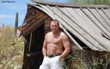 handsome gay man hiking desert.jpg