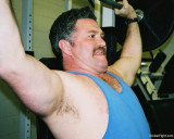 handsome moustache man lifting weights.jpg