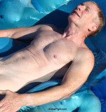 hot guy swimming pool floating.jpg
