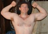huge muscular cowboy flexing muscles.jpg