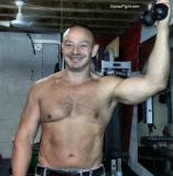 musclebound gay man home gym.jpg