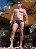 muscleman standing pool outside.jpg