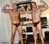 two stocky men flexing biceps.jpg
