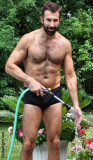 very hot handsome man cleaning pool.jpg