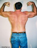carolina jim flexing back muscles.jpg