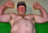 huge man flexing big arms.jpg