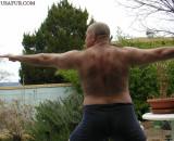 musclebear flexing stretching.jpg