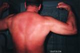 sunburned daddy flexing.jpg