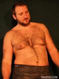 irish ironsmith working shirtless.jpg