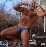 swim trunks dad flexing.JPG