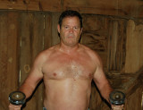 beefy farmer man workingout barn.jpg