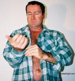 carolina jim removing flannel shirt.jpg