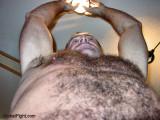 dad changing lightbulb shirtless.jpg