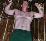 hairy cowboy showing muscles.jpg