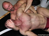 wrestler pulling back on his neck.jpg