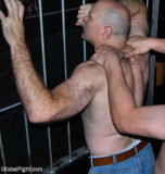 prisoner getting manhandled by guard.jpg