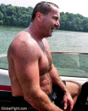 dad climbing into boat.jpg