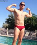 wet guy swimming pool flexing.jpg