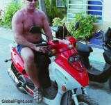 hot daddy riding moped.jpg