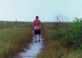 man walking beach nude.jpg