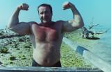 old man flexing beach.jpg