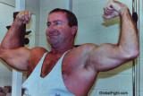 cop flexing big arms.jpg