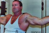 cop flexing big biceps.jpg