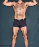 muscle man wearing speedos.jpg