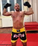 muscular boxer flexing.jpg
