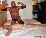 flexing over his beat opponent.jpg