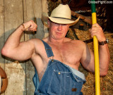 cowboy daddie flexing biceps.jpg