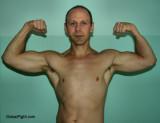 muscle guy flexing.jpg
