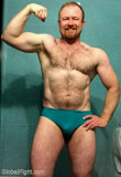 redhead flexing hairy muscles.jpg