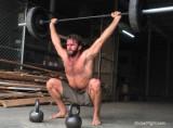 very hot man lifting weights.jpg