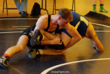 collegiate wrestlers practicing moves.jpg
