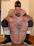 wrestler beating up his opponent.jpg