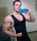 hot muscleman tanktop.jpg