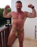 muscle stud flexing.jpg