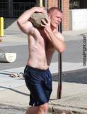 muscleman carrying rocks boulder.jpg