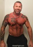 muscleman tattooed beefy chest.jpg