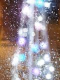lights through rainy window