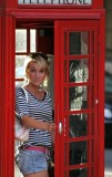 girl in red phone booth-London