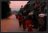 Monks back from collecting Alms in the dawning day. Luang Prabang.