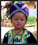 A Young Hmong Girl in Traditional Costume. North Laos.