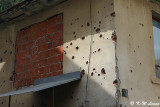 Wall with bullet and shrapnel holes DSC_6167