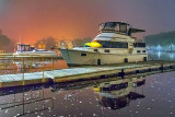 Docked Boats Under Foggy Night Sky 35164