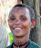 Amharic woman in Yebab near Bahirdar with tattoos. The cross on her forehead shows that she is a Christian. Ethiopia