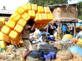 Transport of water canisters in the market of Bahir Dar. Ethiopia.