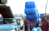 Transport of plastic barrels in a street of Addis Ababa. Ethiopia.