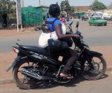 Mother and her baby on a motorbike, Burkina Faso